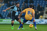 Wycombe Wanderers Sam Wood nicks the ball past Mansfield Town's Chris Clements during the Sky Bet League 2 match between Mansfield Town and Wycombe Wanderers at the One Call Stadium, Mansfield, England on 31 October 2015. Photo by Garry Griffiths.