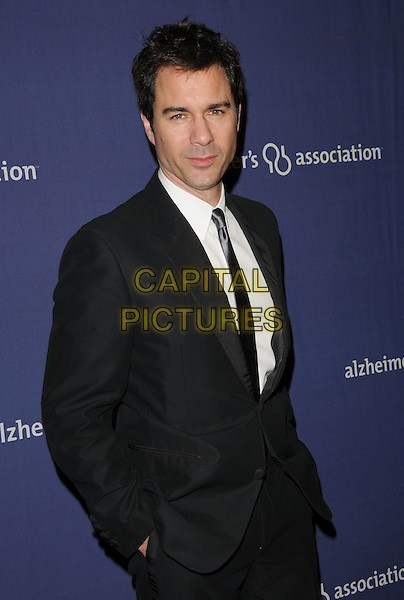 "ERIC McCORMACK .at The 18th Annual ""A Night at Sardi's"" Fundraiser & Awards Dinner held at The Beverly Hilton Hotel in The Beverly Hills, California, USA, March 18th 2010..half length suit hands in pockets black white shirt tie grey gray silk                                                      .CAP/RKE/DVS.©DVS/RockinExposures/Capital Pictures."