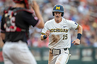 Michigan Wolverines first baseman Jimmy Kerr (15) scores a run during Game 1 of the NCAA College World Series against the Texas Tech Red Raiders on June 15, 2019 at TD Ameritrade Park in Omaha, Nebraska. Michigan defeated Texas Tech 5-3. (Andrew Woolley/Four Seam Images)