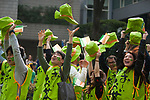 Participants dressed as Itoen Ooi Ocha Green Tea bottles catch their hats while performing during the 25th Annual St. Patrick's Day Parade on Sunday, March 19, 2017 in Tokyo, Japan.<br /> Photo by Kevin Clifford