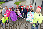 ON THE RUN: Gordon Flannery and Tom Groarke (right) of the Kerry Crusaders with staff and pupils from the Nano Nagle School in Listowel which will benefit from the forthcoming Jingle Run next weekend.