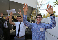 NWA Democrat-Gazette/DAVID GOTTSCHALK  Josh Pinter (from right), a civil engineering student at the University of Arkansas, and Gary Prinz, the director of the Civil Engineering Research and Education Center, call the Hogs  Monday, November 4, 2019, during a groundbreaking ceremony for the Civil Engineering Research and Education Center at the University of Arkansas Research and Technology Park in Fayetteville. The center will allow researchers, government organizations and industrial partners from across the state to conduct cutting-edge research. Students will use the center's design and construction process to explore topics in construction techniques and management, computer-aided design and drafting, plan development, construction materials, soil mechanics and foundation design, structural steel design and reinforced concrete design.
