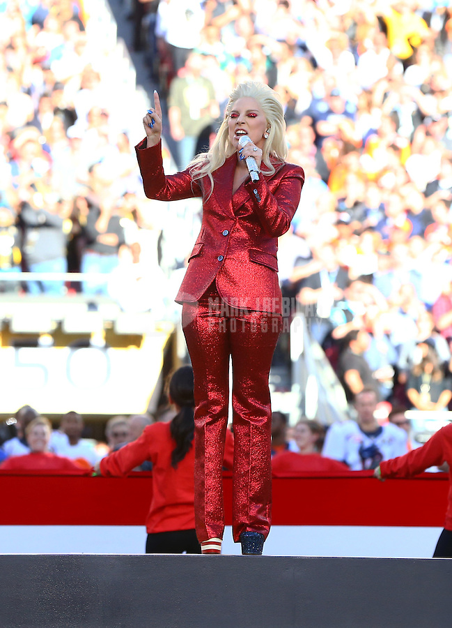 Feb 7, 2016; Santa Clara, CA, USA; Recording artist Lady Gaga performs the national anthem before Super Bowl 50 between the Carolina Panthers and the Denver Broncos at Levi's Stadium. Mandatory Credit: Mark J. Rebilas-USA TODAY Sports