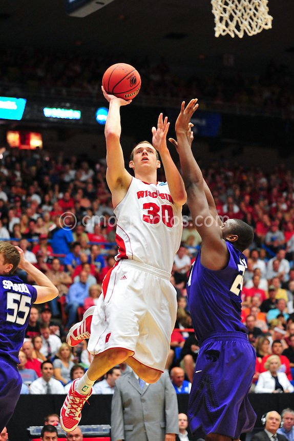 Mar 19, 2011; Tucson, AZ, USA; Wisconsin Badgers forward Jon Leuer (30) shoots the ball in the first half of a game against the Kansas State Wildcats in the third round of the 2011 NCAA men's basketball tournament at the McKale Center.