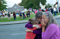 BURLINGTON, WA - SEPTEMBER 26: From left to right: Darci Ridenhour, Kathy Shelman, and Patti Bannister weep after leaving flowers at the memorial outside the Cascade Mall on September 26, 2016 in Burlington, Washington. They then joined hundreds of others for a candlelight vigil. Five people were shot and killed by a gunman several days ago. The suspect, Arcan Cetin, 20, a resident of Oak Harbor, Washington, made a court appearance today. (Photo by Karen Ducey/Getty Images)