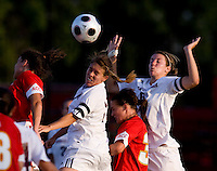 Santa Clara midfielder (12) Kendra perry heads the ball in the box as she and teammate (5) Kiki Bosio squeeze Maryland midfielder (34) Danielle Hubka.  Maryland defeated Santa Clara, 1-0, at Ludwig Field in College Park Maryland.