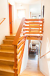 A unique wooden railing along the staircase of a contemporary home. This image is available through an alternate architectural stock image agency, Collinstock located here: http://www.collinstock.com