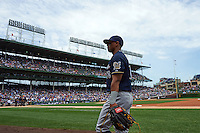 Milwaukee Brewers outfielder Khris Davis (18) walks to the dugout before a game against the Chicago Cubs on August 13, 2015 at Wrigley Field in Chicago, Illinois.  Chicago defeated Milwaukee 9-2.  (Mike Janes/Four Seam Images)