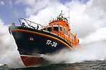 A Severn class lifeboat manned by Falmouth RNLI volunteers powers it's way through the swells in Falmouth Bay, Cornwall 2008.