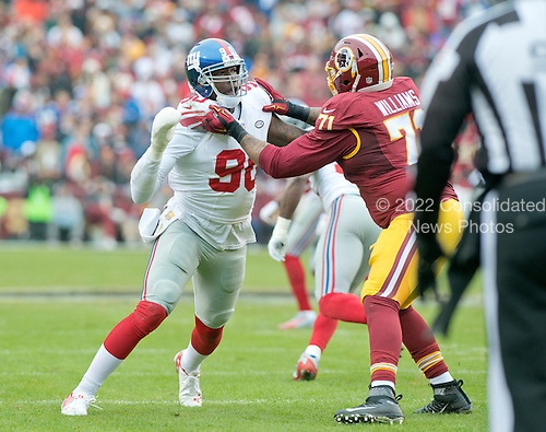 New York Giants defensive end Jason Pierre-Paul (90) rushes against Washington Redskins tackle Trent Williams (71) in first quarter action at FedEx Field in Landover, Maryland on Sunday, November 29, 2015.<br /> Credit: Ron Sachs / CNP<br /> (RESTRICTION: NO New York or New Jersey Newspapers or newspapers within a 75 mile radius of New York City)
