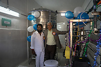 Ravi Sewak, right, stands with the local village leader following the launch of a Safe Water Network iJal station in village Marepally, Telangana, Indiia, on Wednesday, February 6, 2019. Photographer: Suzanne Lee for Safe Water Network