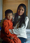Eulalia Miguel and her son Cristopher pose at a shelter in San Antonio, Texas, on December 1, 2015. Miguel and her son fled Guatemala in 2015 because of domestic violence. After requesting political asylum in the United States, they were held for several days by immigration officials and then released, after which they stayed in the shelter, which is run by the Refugee and Immigrant Center for Education and Legal Services (RAICES), and supported by a coalition of San Antonio churches. After that, they traveled by bus to a new location in the United States, where they will live pending a final decision on her request for asylum.