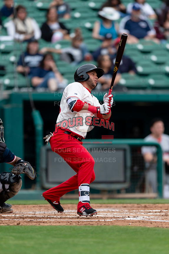 Fresno Grizzlies outfielder Yadiel Hernandez (13) hits a home run during a game against the Reno Aces at Chukchansi Park on April 8, 2019 in Fresno, California. Fresno defeated Reno 7-6. (Zachary Lucy/Four Seam Images)