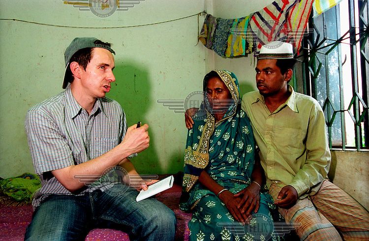 A Der Spiegel journalist talks with the mother and brother of one of the victims killed when a garment factory collapsed in the Savar region, killing 70 and injuring over 100. The garment industry accounts for four-fifths of Bangladesh's foreign revenues and employs about 1.8 million workers, mostly women and mostly low paid. Garment workers regularly die in industrial accidents and safety standards remain low by international standards.