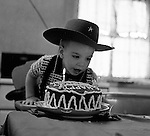 Bethel Park PA:  Michael Stewart blowing out the candles on his birthday cake - 1955