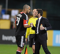 D.C. United head coach Ben Olsen celebrates forward Maicon Santos (29) first goal of the game in the 28th minute of the game. D.C. United defeated FC Dallas 4-1 at RFK Stadium, Friday March 30, 2012.