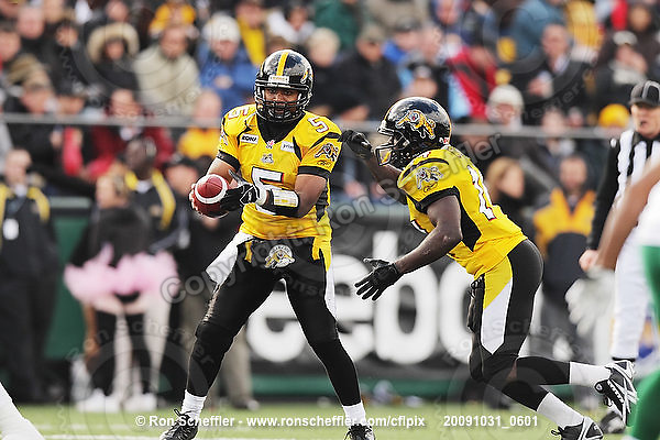October 31, 2009; Hamilton, ON, CAN;  Hamilton Tiger-Cats quarterback Kevin Glenn (5) and running back DeAndra' Cobb (14). CFL football: Saskatchewan Roughriders vs. Hamilton Tiger-Cats at Ivor Wynne Stadium. The Tiger-Cats defeated the Roughriders 24-6. Mandatory Credit: Ron Scheffler. Copyright (c) 2009 Ron Scheffler.