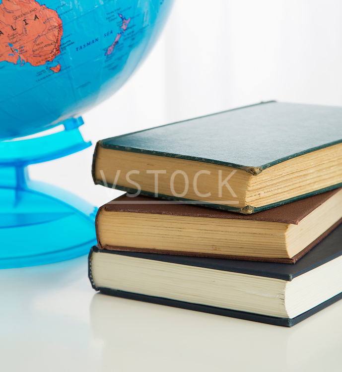 Globe and stack of books