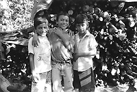 Young boys attending a friend's birthday party. Community of Nueva Esperanza, El Salvador, 1999.