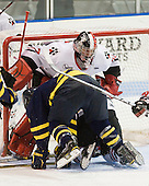 Karl Stollery (Merrimack - 7), Chris Rawlings (Northeastern - 37) - The visiting Merrimack College Warriors defeated the Northeastern University Huskies 4-3 (OT) on Friday, February 4, 2011, at Matthews Arena in Boston, Massachusetts.