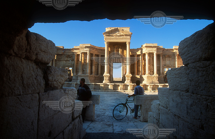 The restored Roman theatre in the ancient ruins of Palmyra. Palmyra (or Tadmor in Arabic) dates back to the Neolithic period and was first mentioned in the second millennium BC as a caravan stop. It later came under the Seleucid Empire and then under the Roman Empire.<br /> In May 2015 Islamic State (IS) forces fighting the Syrian government of President Assad took control of the modern settlement of Tadmur and the historic site. There are fears that the priceless treasures could fall victim to IS's iconoclastic destruction that has seen museums and ancient sites across Syria and Iraq destroyed.