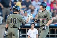 Vanderbilt Commodores outfielder JJ Bleday (51) is congratulated by teammate Ethan Paul (10) after hitting a home run against the Michigan Wolverines during Game 1 of the NCAA College World Series Finals on June 24, 2019 at TD Ameritrade Park in Omaha, Nebraska. Michigan defeated Vanderbilt 7-4. (Andrew Woolley/Four Seam Images)