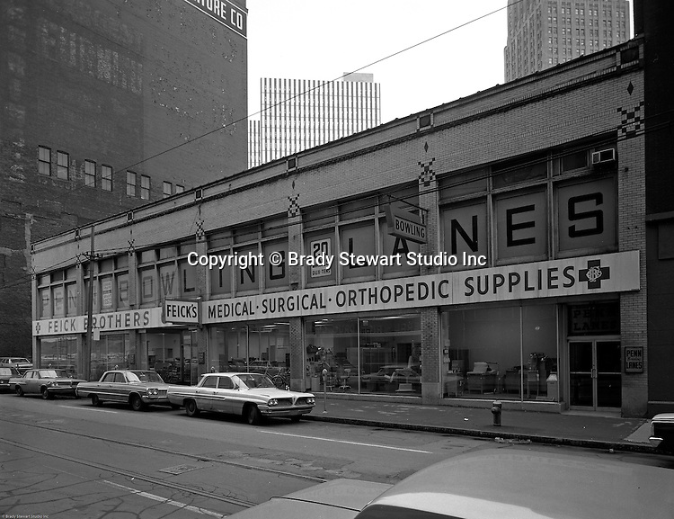 Pittsburgh PA:  View of Feick Brothers Medical Supplies Company and Penn Avenue Bowling Lanes on Penn Avenue in Pittsburgh - 1960s.  Feick Brothers was established in Pittsburgh in the 1880s.  For 50+ years, Feick was one of the best known manufacturer and supplier of medical equipment.