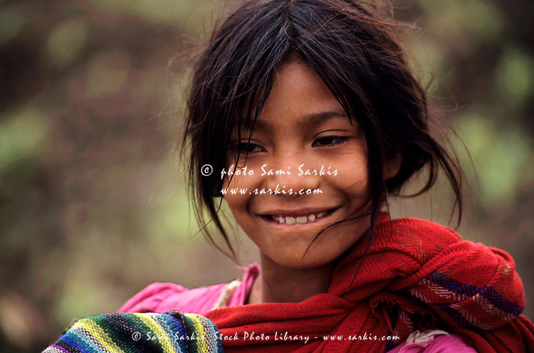 Portrait of a smiling Guatemalan girl at a refugee camp, Chiapas, Mexico.
