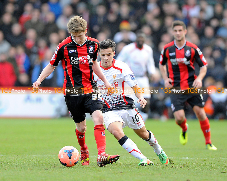Eunan O'Kane of AFC Bournemouth goes past Philippe Coutinho of Liverpool - AFC Bournemouth vs Liverpool - FA Cup 4th Round Football at the Goldsands Stadium, Bournemouth, Dorset - 25/01/14 - MANDATORY CREDIT: Denis Murphy/TGSPHOTO - Self billing applies where appropriate - 0845 094 6026 - contact@tgsphoto.co.uk - NO UNPAID USE