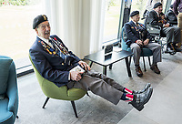Simeon Mayou, 96, wears his Legion D'Honour medal as he shows-off his Union flag socks during a service at the National Memorial Arboretum in Alrewas, Staffordshire, during an event to commemorate the 75th anniversary of the D-Day landings. Photo Credit: ALPR/AdMedia