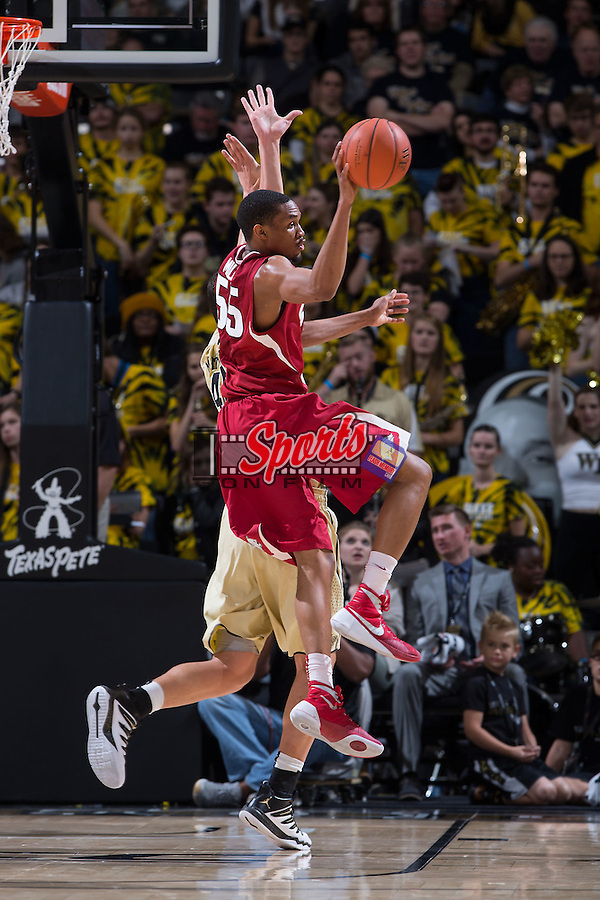Keaton Miles (55) of the Arkansas Razorbacks passes the ball during second half action against the Wake Forest Demon Deacons at the LJVM Coliseum on December 4, 2015 in Winston-Salem, North Carolina.  The Demon Deacons defeated the Razorbacks 88-85.  (Brian Westerholt/Sports On Film)