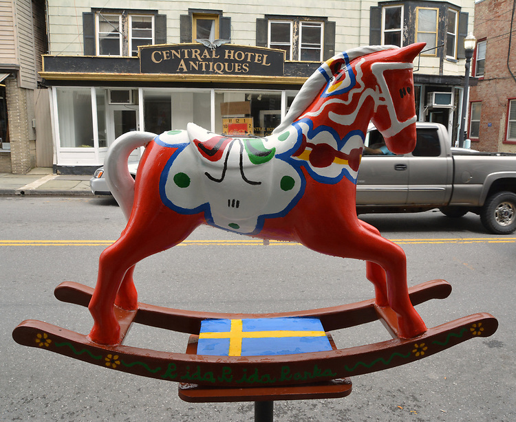 "A view of, ""Dala Horse"" by artist, Jacqueline L. Vought, one of the 35 Artist painted Rocking Horses on display around Saugerties, NY as part of the Chamber of Commerce sponsored Art in the Village Project titled ""Rockin' Around Saugerties."" This photo taken on Friday, May 26, 2017. Photo by Jim Peppler. Copyright/Jim Peppler-2017."