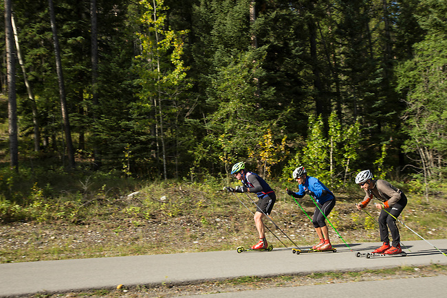 Nordic skiers are seen here training off-season with roller skies at the Canmore Nordic Centre, in Canmore Alberta, Canada, on the last day of summer 2013.