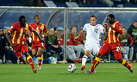 Landon Donovan of USA takes on Kwadwo Asahmoah, Andre Ayew and Hans Sarpei of Ghana. USA vs Ghana in the 2010 FIFA World Cup at Royal Bafokeng Stadium in Rustenburg, South Africa on June 26, 2010.