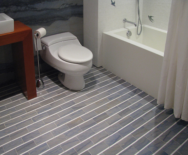 Gracie, a natural stone mosaic, is shown in polished Blue Lightning and Thassos.