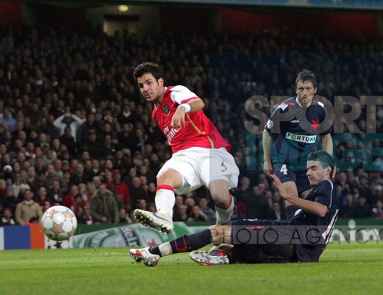 Arsenal's Cesc Fabregas scoring his sides sixth goal