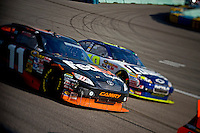 """Denny Hamlin (#11) and Jimmie Johnson (#48) line up the together for a restart, the only time that Hamlin would """"lead"""" Johnson in the points since the start of the race."""