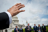 House Minority Leader Rep. Kevin McCarthy (R-Calif.) fields questions for reporters during a media availability with House Minority Whip Rep. Steve Scalise (R-LA), House GOP Conference Chairwoman Liz Cheney (R-WY) and others, to announce that Republican leaders have filed a lawsuit against House Speaker Nancy Pelosi and congressional officials in an effort to block the House of Representatives from using a proxy voting system to allow for remote voting during the coronavirus pandemic, outside of the U.S. Capitol in Washington, DC., Wednesday, May 27, 2020. Credit: Rod Lamkey / CNP/AdMedia