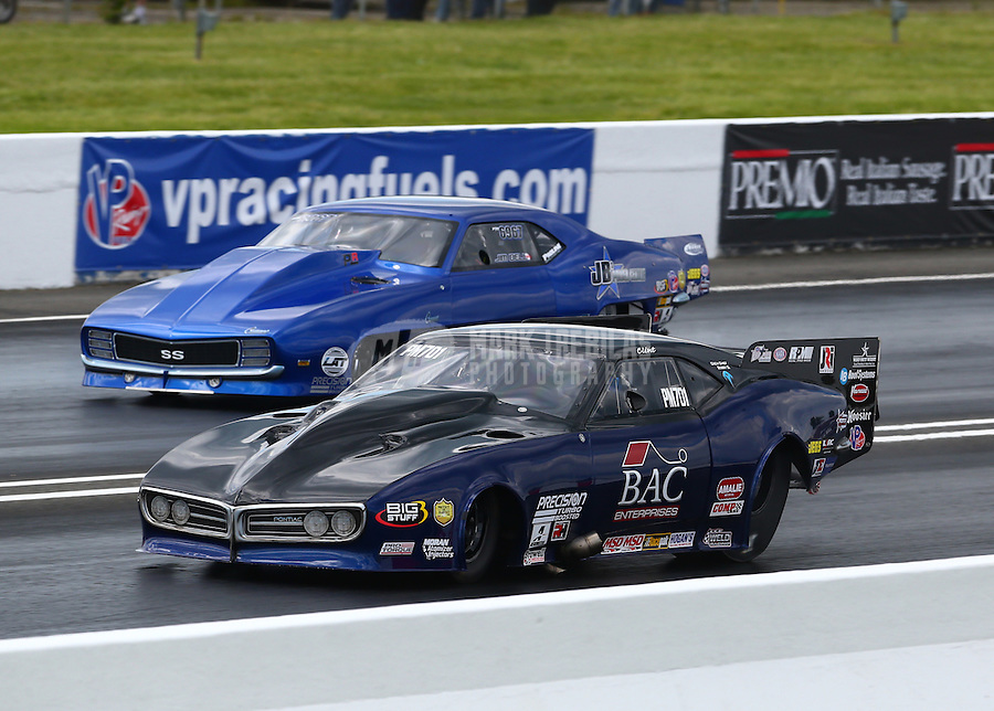 May 30, 2014; Englishtown, NJ, USA; NHRA pro mod driver Clint Satterfield (near lane) races alongside Jim Bell during qualifying for the Summernationals at Raceway Park. Mandatory Credit: Mark J. Rebilas-
