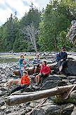 CANADA, Vancouver, British Columbia, portrait of a family and friends at Brigade Bay on Gambier Island, in the Howe Sound