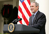 Washington, D.C. - December 2, 2005 --  United States President George W. Bush makes remarks on the economy in the Rose Garden of the White House in Washington, DC on Friday 02 December 2005. A government report showed the U.S. economy in November added the most jobs in four months.<br /> Credit: Matthew Cavanaugh-Pool via CNP