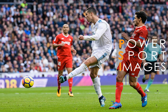 Cristiano Ronaldo of Real Madrid (L) attempts a kick while being defended by Jesus Navas of Sevilla FC (R) during La Liga 2017-18 match between Real Madrid and Sevilla FC at Santiago Bernabeu Stadium on 09 December 2017 in Madrid, Spain. Photo by Diego Souto / Power Sport Images