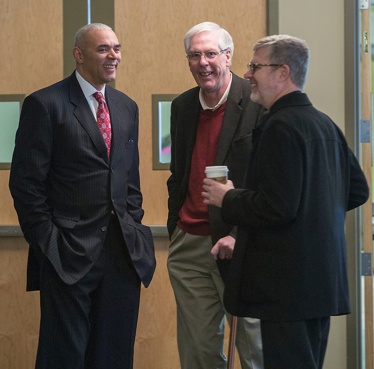 Head coach Dave Leitao, left, Jim Doyle, former vice president of Student Affairs, and the Rev. Dennis H. Holtschneider, C.M., president of DePaul University, chat in the wings of the Student Center Monday, March 30, 2015, before Leitao was introduced as the new head coach of the men's basketball program. (DePaul University/Jamie Moncrief)