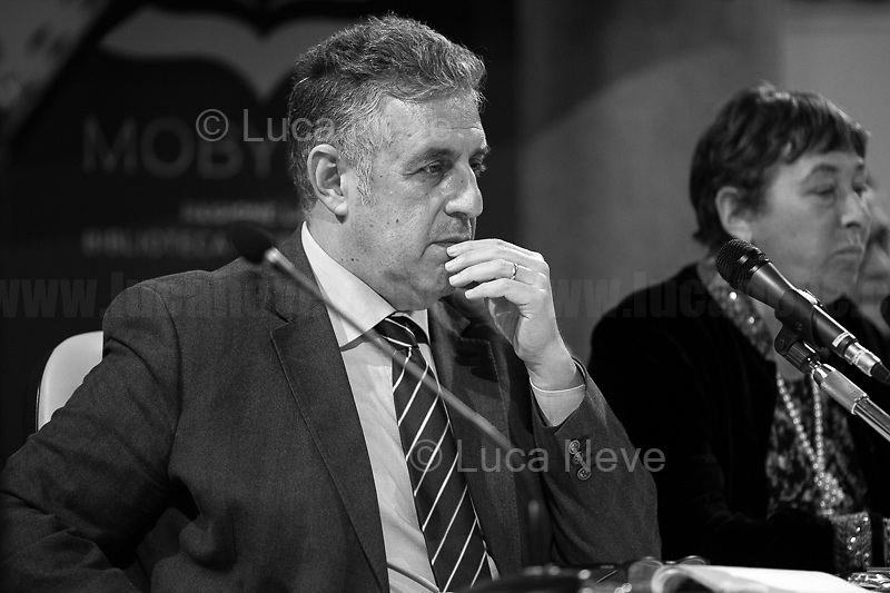 """(From L to R) Di Matteo, Resta.<br /> <br /> Rome, 08/02/19. Moby Dick Library in Garbatella & Antimafia Duemila(2.) held the presentation of the book """"Il Patto Sporco"""" (The Dirty Pact. The Trial State-mafia in the Story [narrated] by his Protagonist, Chiarelettere,1.) hosted by the author of the book Saverio Lodato (Journalist & Author), Antonino 'Nino' Di Matteo (Protagonist of the book, Antimafia Magistrate of Palermo, member of the DNA - Antimafia & Antiterrorism National Directorate - who """"prosecuted the Italian State for conspiring with the Mafia in acts of murder & terror"""",3.4.5.6.) & Giorgio Bongiovanni (Editor of Antimafia Duemila). Chair of the event was Silvia Resta (Journalist & Author). Readers were: Bianca Nappi & Carlotta Natoli (both Actresses). From the back cover of the book: """"Let us ask ourselves why politics, institutions, culture, have needed the words of judges to finally begin to understand…A handful of magistrates and investigators have shown not to be afraid to prosecute the [Italian] State. Now others must do their part too"""" (Nino Di Matteo). """"In the pages of this book I wanted the magistrate, the man, the protagonist and the witness to speak about a trial destined to leave its mark"""" (Saverio Lodato). From the book online page: """"The attacks to Lima [politician], Falcone & Borsellino [Judges], the bombs in Milan, Florence, Rome, the murders of valiant police commissioners & officers of the carabinieri. The [Ita] State on its knees, its best men sacrificed. However, while the blood of the massacres was still running there were those who, precisely in the name of the State, dialogued and interacted with the enemy. The sentence of condemnation of Palermo [""""mafia-State negotiation"""" trial which is told in the book], against the opinion of many 'deniers', proved that the negotiation not only was there but did not avoid more blood. On the contrary, it provoked it""""(1.).<br /> Footnotes & links provided at 2nd & last page."""