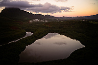 Aerial view of the Menehune (or Alekoko) Fishpond at sunrise near Lihu'e, Kaua'i. Listed on the U.S National Register of Historic places, it is said that menehune built this ancient fishpond.