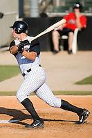 First baseman Mark Fleisher (34) of the Kannapolis Intimidators follows through on his swing at Fieldcrest Cannon Stadium in Kannapolis, NC, Sunday June 15, 2008.