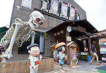 Visitors enjoy bronze statues of characters by Shigeru Mizuki on a street named after the manga artist in his home town of Sakaiminato, Tottori Prefecture, Japan..Photographer: Robert Gilhooly