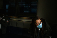 NEW YORK, NEW YORK - MARCH 03 : A woman wears a face mask as she rides the air train inside the John F. Kennedy International Airport in New York on March 03, 2020. New York confirms second coronavirus case, as flights cancelations and Jewish schools close over virus fears.The first person to test positive for coronavirus in the state is a 39-year-old health-care worker who arrived from Iran with her husband, the second one is an attorney who lives in Westchester County, works in Manhattan, Gov. Andrew Cuomo said. (Photo by Eduardo Munoz / VIEWpress via Getty Images)