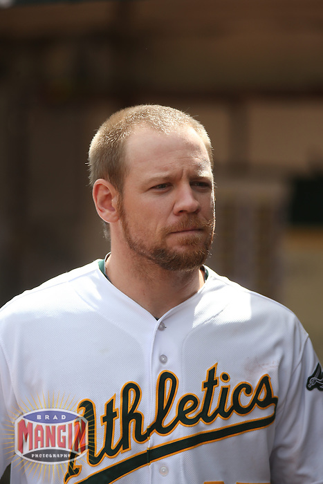 OAKLAND, CA - APRIL 2:  Brandon Moss #37 of the Oakland Athletics stands in the dugout against the Cleveland Indians during the game at O.co Coliseum on Wednesday, April 2, 2014 in Oakland, California. Photo by Brad Mangin