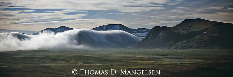 Clouds roll over the peaks of the Alaska range in Denali National Park, Alaska.
